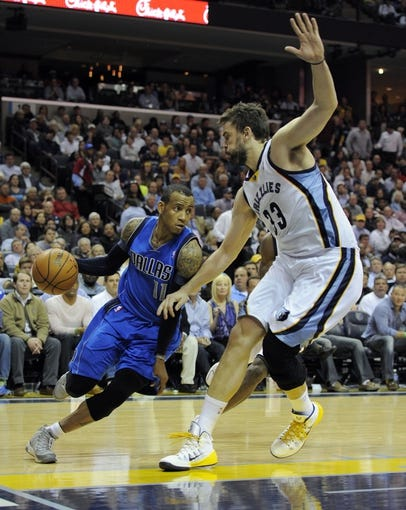 Apr 16, 2014; Memphis, TN, USA; Dallas Mavericks guard Monta Ellis (11) drives to the basket against Memphis Grizzlies center Marc Gasol (33) during the game at FedExForum. Memphis Grizzlies beat the Dallas Mavericks in overtime 106 - 105. Mandatory Credit: Justin Ford-USA TODAY Sports