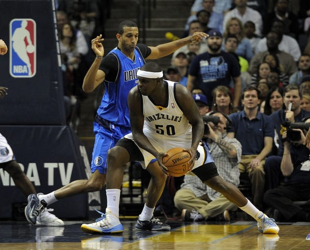 Apr 16, 2014; Memphis, TN, USA; Memphis Grizzlies forward Zach Randolph (50) drives to the basket against Dallas Mavericks forward Brandan Wright (34) during the game at FedExForum. Memphis Grizzlies beat the Dallas Mavericks in overtime 106 - 105. Mandatory Credit: Justin Ford-USA TODAY Sports