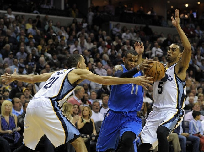 Apr 16, 2014; Memphis, TN, USA; Dallas Mavericks guard Monta Ellis (11) drives to the basket against Memphis Grizzlies forward Tayshaun Prince (21) and Memphis Grizzlies guard Courtney Lee (5) during the game at FedExForum. Memphis Grizzlies beat the Dallas Mavericks in overtime 106 - 105. Mandatory Credit: Justin Ford-USA TODAY Sports