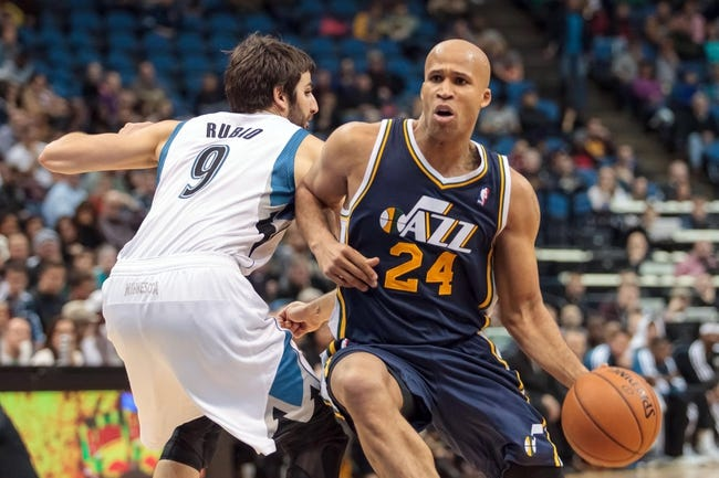 Apr 16, 2014; Minneapolis, MN, USA; Utah Jazz forward Richard Jefferson (24) dribbles in double overtime against the Minnesota Timberwolves guard Ricky Rubio (9) at Target Center. The Utah Jazz win 136-130 in double overtime. Mandatory Credit: Brad Rempel-USA TODAY Sports