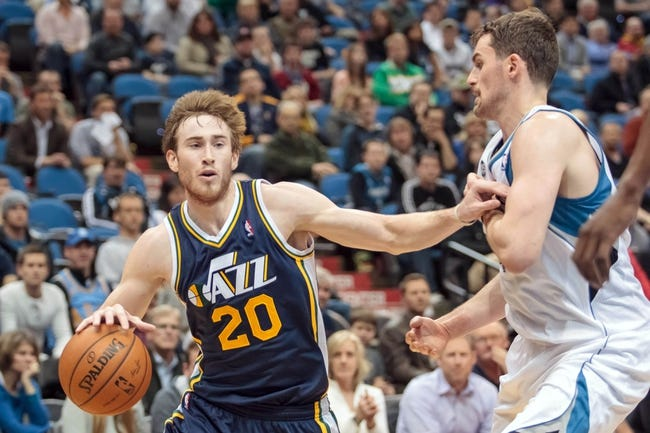 Apr 16, 2014; Minneapolis, MN, USA; Utah Jazz guard Gordon Hayward (20) dribbles in double overtime against the Minnesota Timberwolves forward Kevin Love (42) at Target Center. The Utah Jazz win 136-130 in double overtime. Mandatory Credit: Brad Rempel-USA TODAY Sports