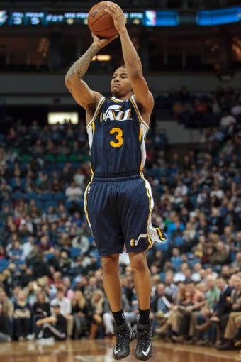 Apr 16, 2014; Minneapolis, MN, USA; Utah Jazz guard Trey Burke (3) shoots in the third quarter against the Minnesota Timberwolves at Target Center. The Utah Jazz win 136-130 in double overtime. Mandatory Credit: Brad Rempel-USA TODAY Sports