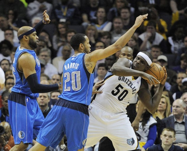 Apr 16, 2014; Memphis, TN, USA; Memphis Grizzlies forward Zach Randolph (50) handles the ball against Dallas Mavericks guard Devin Harris (20) and Dallas Mavericks guard Vince Carter (25) during the game at FedExForum. Memphis Grizzlies beat the Dallas Mavericks in overtime 106 - 105. Mandatory Credit: Justin Ford-USA TODAY Sports