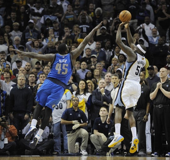 Apr 16, 2014; Memphis, TN, USA; Memphis Grizzlies forward Zach Randolph (50) shoots over Dallas Mavericks center DeJuan Blair (45) during the game at FedExForum. Memphis Grizzlies beat the Dallas Mavericks in overtime 106 - 105. Mandatory Credit: Justin Ford-USA TODAY Sports