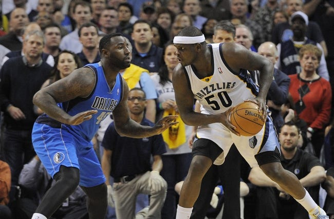 Apr 16, 2014; Memphis, TN, USA; Memphis Grizzlies forward Zach Randolph (50) is guarded by Dallas Mavericks center DeJuan Blair (45) during the game at FedExForum. Memphis Grizzlies beat the Dallas Mavericks in overtime 106 - 105. Mandatory Credit: Justin Ford-USA TODAY Sports