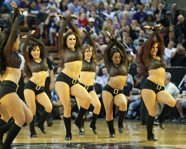 Apr 16, 2014; Sacramento, CA, USA; Sacramento Kings dancers perform during a timeout against the Phoenix Suns during the second quarter at Sleep Train Arena. Mandatory Credit: Kelley L Cox-USA TODAY Sports