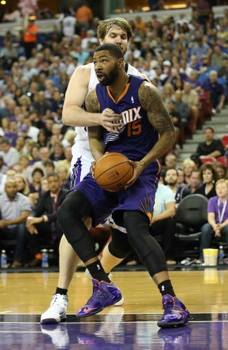 Apr 16, 2014; Sacramento, CA, USA; Sacramento Kings center Aaron Gray (33) fouls Phoenix Suns forward Marcus Morris (15) during the second quarter at Sleep Train Arena. Mandatory Credit: Kelley L Cox-USA TODAY Sports