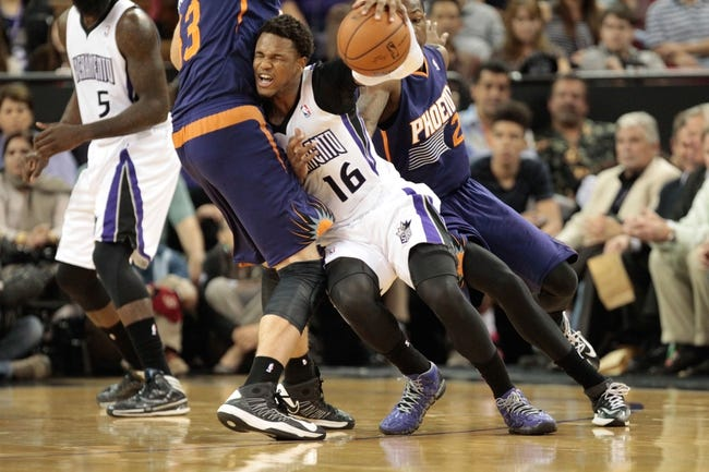 Apr 16, 2014; Sacramento, CA, USA; Phoenix Suns forward Shavlik Randolph (43) fouls Sacramento Kings guard Ben McLemore (16) during the second quarter at Sleep Train Arena. Mandatory Credit: Kelley L Cox-USA TODAY Sports