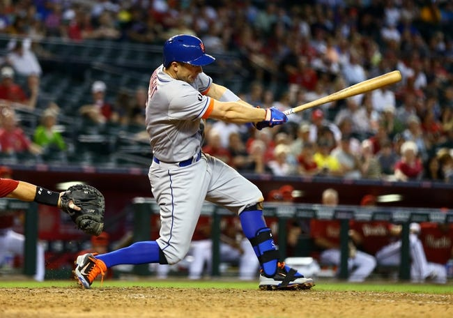 Apr 16, 2014; Phoenix, AZ, USA; New York Mets third baseman David Wright hits an RBI single in the ninth inning against the Arizona Diamondbacks at Chase Field. The Mets defeated the Diamondbacks 5-2. Mandatory Credit: Mark J. Rebilas-USA TODAY Sports