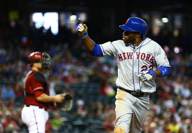 Apr 16, 2014; Phoenix, AZ, USA; New York Mets outfielder Eric Young Jr celebrates after scoring against the Arizona Diamondbacks at Chase Field. The Mets defeated the Diamondbacks 5-2. Mandatory Credit: Mark J. Rebilas-USA TODAY Sports