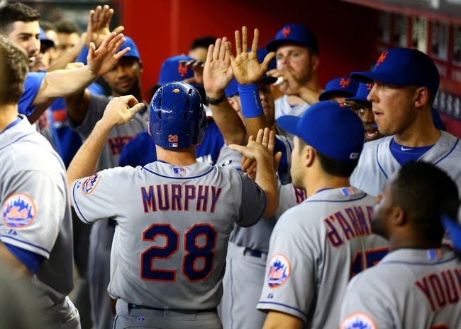 Apr 16, 2014; Phoenix, AZ, USA; New York Mets second baseman Daniel Murphy (28) celebrates with teammates after scoring in the ninth inning against the Arizona Diamondbacks at Chase Field. The Mets defeated the Diamondbacks 5-2. Mandatory Credit: Mark J. Rebilas-USA TODAY Sports