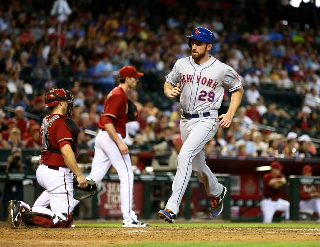 Apr 16, 2014; Phoenix, AZ, USA; New York Mets first baseman Ike Davis scores against the Arizona Diamondbacks at Chase Field. The Mets defeated the Diamondbacks 5-2. Mandatory Credit: Mark J. Rebilas-USA TODAY Sports