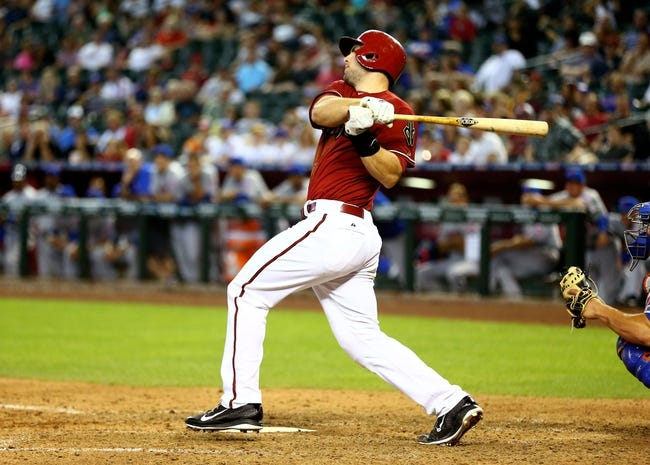 Apr 16, 2014; Phoenix, AZ, USA; Arizona Diamondbacks first baseman Paul Goldschmidt hits a solo home run in the ninth inning against the New York Mets at Chase Field. The Mets defeated the Diamondbacks 5-2. Mandatory Credit: Mark J. Rebilas-USA TODAY Sports