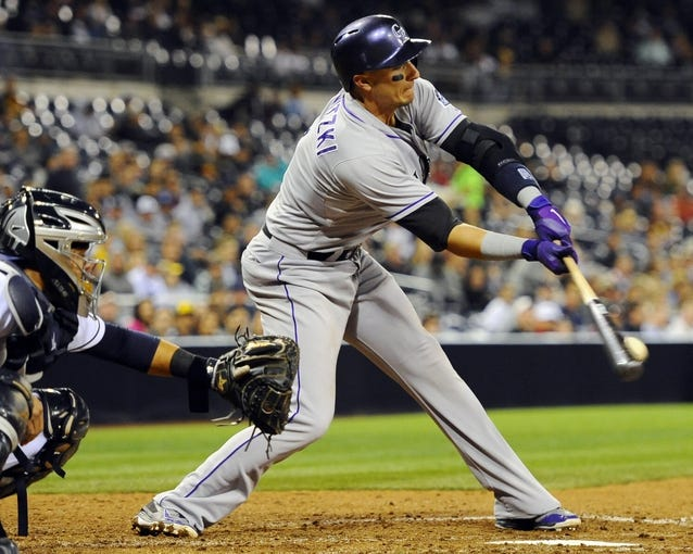 Apr 16, 2014; San Diego, CA, USA; Colorado Rockies shortstop Troy Tulowitzki (2) grounds out during the eighth inning against the San Diego Padres at Petco Park. Mandatory Credit: Christopher Hanewinckel-USA TODAY Sports