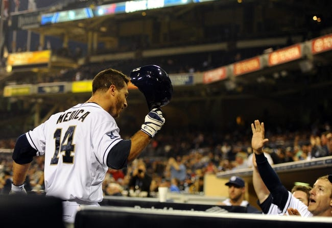 Apr 16, 2014; San Diego, CA, USA; San Diego Padres left fielder Tommy Medica (14) is congratulated by center fielder Chris Denorfia (13) and teammates after a home run during the second inning against the Colorado Rockies at Petco Park. Mandatory Credit: Christopher Hanewinckel-USA TODAY Sports