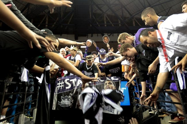 Apr 16, 2014; Sacramento, CA, USA; Sacramento Kings fans reach for jerseys and player items after the game against the Phoenix Suns at Sleep Train Arena. The Phoenix Suns defeated the Sacramento Kings 104-99. Mandatory Credit: Kelley L Cox-USA TODAY Sports