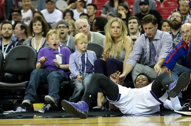 Apr 16, 2014; Sacramento, CA, USA; Sacramento Kings guard Ben McLemore (16) falls in front of minority owner Mark Mastrov and family after being fouled on a three point shot against the Phoenix Suns during the fourth quarter at Sleep Train Arena. The Phoenix Suns defeated the Sacramento Kings 104-99. Mandatory Credit: Kelley L Cox-USA TODAY Sports