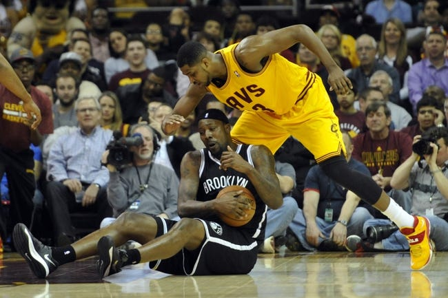 Apr 12, 2014; Cleveland, OH, USA; Cleveland Cavaliers forward Tristan Thompson (13) defends Brooklyn Nets center Andray Blatche (0) in the first quarter at Quicken Loans Arena. Mandatory Credit: David Richard-USA TODAY Sports