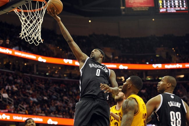 Apr 12, 2014; Cleveland, OH, USA; Brooklyn Nets center Andray Blatche (0) drives to the basket in the first quarter against the Cleveland Cavaliers at Quicken Loans Arena. Mandatory Credit: David Richard-USA TODAY Sports