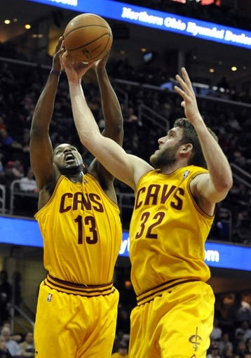 Apr 12, 2014; Cleveland, OH, USA; Cleveland Cavaliers forward Tristan Thompson (13) grabs a rebound beside center Spencer Hawes (32) in the first quarter against the Brooklyn Nets at Quicken Loans Arena. Mandatory Credit: David Richard-USA TODAY Sports
