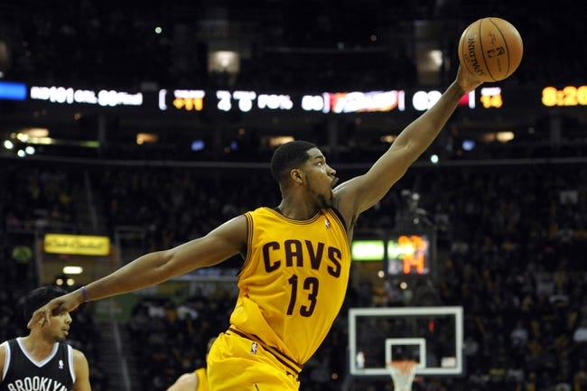 Apr 12, 2014; Cleveland, OH, USA; Cleveland Cavaliers forward Tristan Thompson (13) reaches for a loose ball in the third quarter against the Brooklyn Nets at Quicken Loans Arena. Mandatory Credit: David Richard-USA TODAY Sports