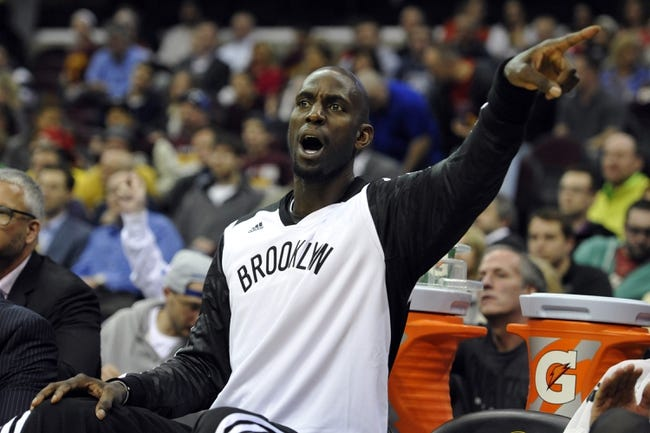 Apr 12, 2014; Cleveland, OH, USA; Brooklyn Nets center Kevin Garnett (2) reacts on the bench in the second quarter against the Cleveland Cavaliers at Quicken Loans Arena. Mandatory Credit: David Richard-USA TODAY Sports