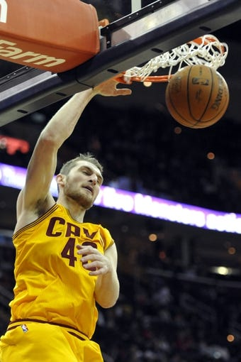 Apr 12, 2014; Cleveland, OH, USA; Cleveland Cavaliers center Tyler Zeller (40) dunks against the Brooklyn Nets in the fourth quarter at Quicken Loans Arena. Mandatory Credit: David Richard-USA TODAY Sports