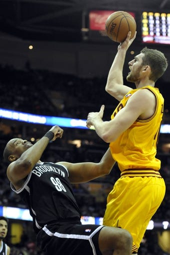 Apr 12, 2014; Cleveland, OH, USA; Cleveland Cavaliers center Tyler Zeller (right) shoots against Brooklyn Nets center Jason Collins (98) in the fourth quarter at Quicken Loans Arena. Mandatory Credit: David Richard-USA TODAY Sports