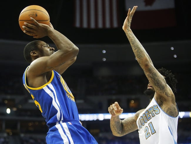 Apr 16, 2014; Denver, CO, USA; Golden State Warriors guard Jordan Crawford (55) shoots the ball during the second half against the Denver Nuggets at Pepsi Center.  The Warriors won 116-112.  Mandatory Credit: Chris Humphreys-USA TODAY Sports