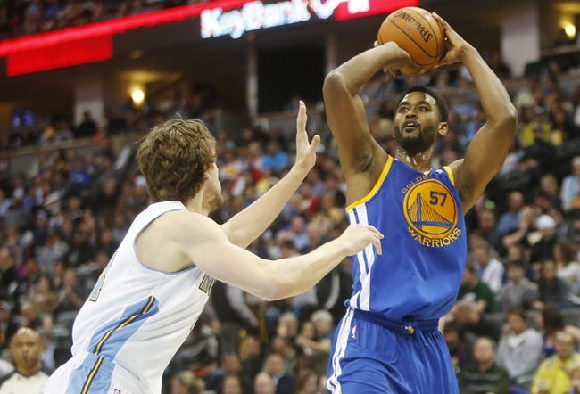 Apr 16, 2014; Denver, CO, USA; Golden State Warriors center Hilton Armstrong (57) shoots the ball during the second half against the Denver Nuggets at Pepsi Center.  The Warriors won 116-112.  Mandatory Credit: Chris Humphreys-USA TODAY Sports