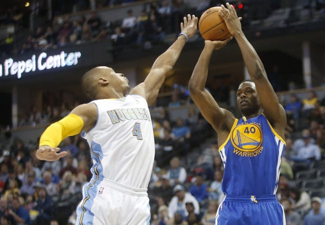 Apr 16, 2014; Denver, CO, USA; Golden State Warriors forward Harrison Barnes (40) shoots the ball over Denver Nuggets guard Randy Foye (4) during the second half at Pepsi Center.  The Warriors won 116-112.  Mandatory Credit: Chris Humphreys-USA TODAY Sports