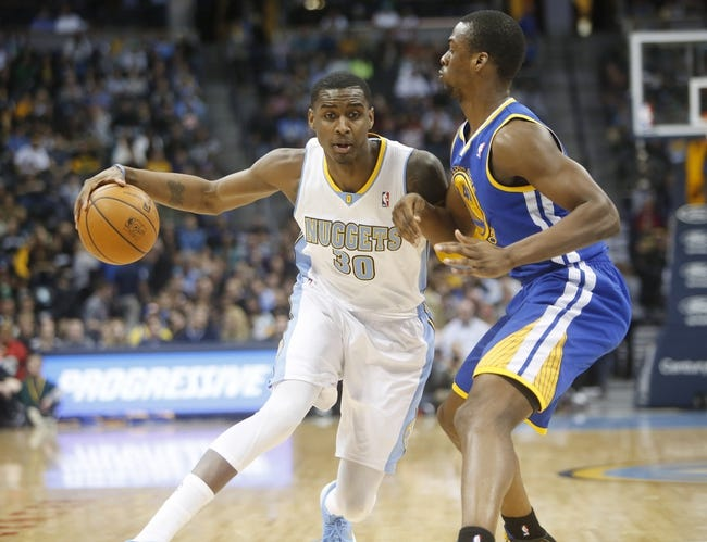 Apr 16, 2014; Denver, CO, USA; Denver Nuggets forward Quincy Miller (30) during the first quarter against the Golden State Warriors at Pepsi Center. Mandatory Credit: Chris Humphreys-USA TODAY Sports