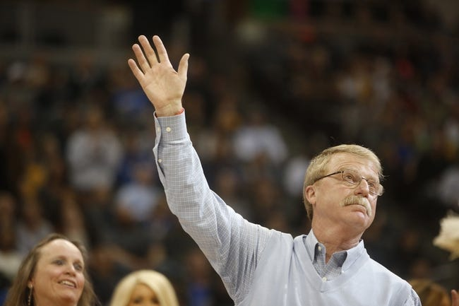 Apr 16, 2014; Denver, CO, USA; Denver Nuggets head athletic trainer Jim Gillen waves to the crowd during a ceremony commemorating his retirement after 23 years with the team before the game against the Golden State Warriors at Pepsi Center. Mandatory Credit: Chris Humphreys-USA TODAY Sports