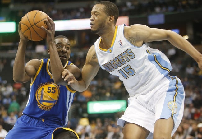 Apr 16, 2014; Denver, CO, USA; Golden State Warriors guard Jordan Crawford (55) drives to the basket against Denver Nuggets forward Anthony Randolph (15) during the second half at Pepsi Center.  The Warriors won 116-112. Mandatory Credit: Chris Humphreys-USA TODAY Sports