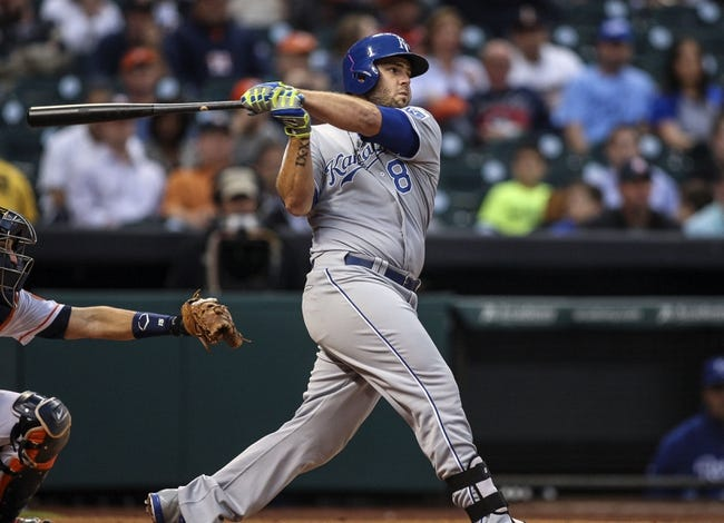 Apr 17, 2014; Houston, TX, USA; Kansas City Royals third baseman Mike Moustakas (8) drives in a run with a single during the second inning against the Houston Astros at Minute Maid Park. Mandatory Credit: Troy Taormina-USA TODAY Sports
