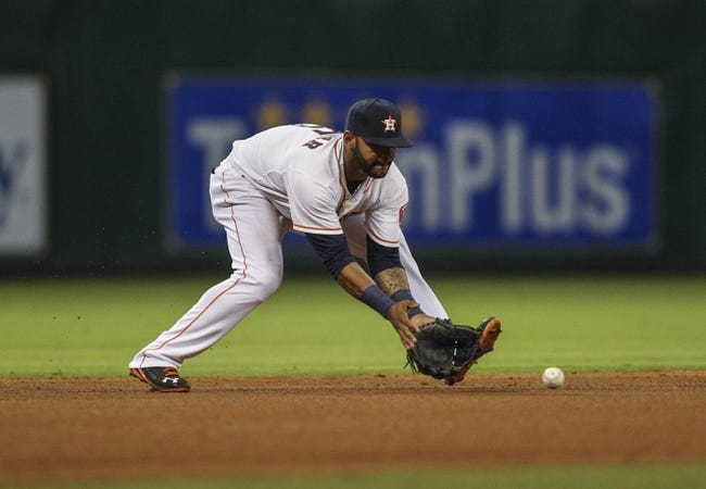 Apr 17, 2014; Houston, TX, USA; Houston Astros shortstop Jonathan Villar (6) fields a ground ball during the fourth inning against the Kansas City Royals at Minute Maid Park. Mandatory Credit: Troy Taormina-USA TODAY Sports