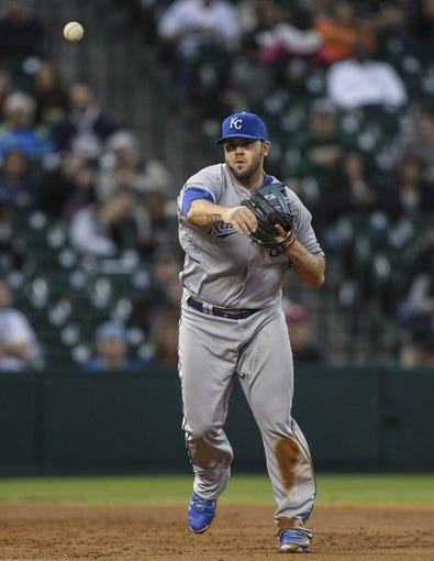 Apr 17, 2014; Houston, TX, USA; Kansas City Royals third baseman Mike Moustakas (8) throws to first base during the second inning against the Houston Astros at Minute Maid Park. Mandatory Credit: Troy Taormina-USA TODAY Sports