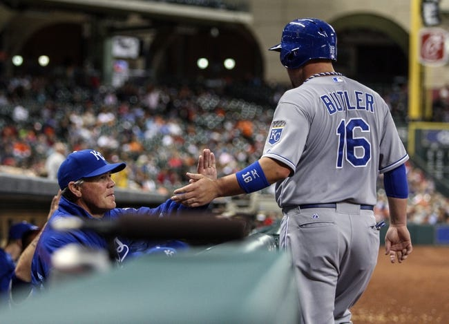 Apr 17, 2014; Houston, TX, USA; Kansas City Royals designated hitter Billy Butler (16) is congratulated by manager Ned Yost (3) after scoring a run during the fourth inning against the Houston Astros at Minute Maid Park. Mandatory Credit: Troy Taormina-USA TODAY Sports