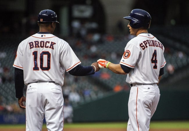 Apr 17, 2014; Houston, TX, USA; Houston Astros right fielder George Springer (4) is congratulated by first base coach Tarrik Brock (10) after getting a single during the first inning against the Kansas City Royals at Minute Maid Park. Mandatory Credit: Troy Taormina-USA TODAY Sports