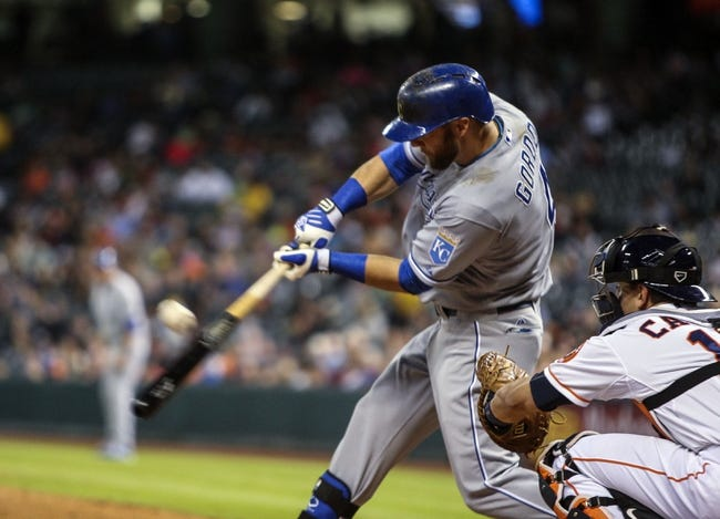 Apr 17, 2014; Houston, TX, USA; Kansas City Royals left fielder Alex Gordon (4) gets a single during the fourth inning against the Houston Astros at Minute Maid Park. Mandatory Credit: Troy Taormina-USA TODAY Sports
