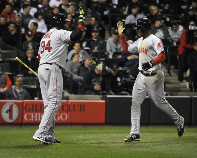 Apr 17, 2014; Chicago, IL, USA; Boston Red Sox shortstop Xander Bogaerts (2) is greeted by designated hitter David Ortiz (34) after hitting a home run against the Chicago White Sox during the sixth inning at U.S Cellular Field. Mandatory Credit: David Banks-USA TODAY Sports