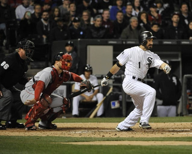 Apr 17, 2014; Chicago, IL, USA; Chicago White Sox center fielder Adam Eaton (1) hits an  RBI single against the Boston Red Sox during the sixth inning at U.S Cellular Field. Mandatory Credit: David Banks-USA TODAY Sports