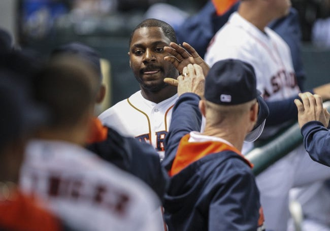 Apr 17, 2014; Houston, TX, USA; Houston Astros designated hitter Chris Carter (23) is congratulated after scoring a run during the fifth inning against the Kansas City Royals at Minute Maid Park. Mandatory Credit: Troy Taormina-USA TODAY Sports