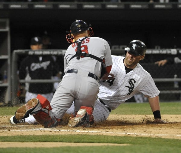 Apr 17, 2014; Chicago, IL, USA; Boston Red Sox catcher David Ross (3) tags out Chicago White Sox designated hitter Adam Dunn (44) during the seventh inning at U.S Cellular Field. Mandatory Credit: David Banks-USA TODAY Sports