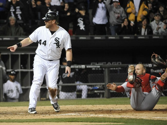 Apr 17, 2014; Chicago, IL, USA; Chicago White Sox designated hitter Adam Dunn (44) reacts after being tagged out by Boston Red Sox catcher David Ross (3) during the seventh inning at U.S Cellular Field. Mandatory Credit: David Banks-USA TODAY Sports
