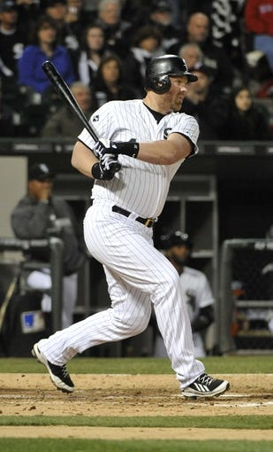 Apr 17, 2014; Chicago, IL, USA; Chicago White Sox designated hitter Adam Dunn (44) hits a single against the Boston Red Sox during the seventh inning at U.S Cellular Field. Mandatory Credit: David Banks-USA TODAY Sports