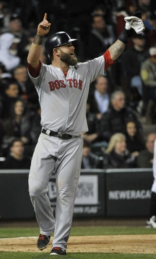 Apr 17, 2014; Chicago, IL, USA;  Boston Red Sox first baseman Mike Napoli (12) reacts after scoring against the Chicago White Sox during the ninth inning at U.S Cellular Field. Mandatory Credit: David Banks-USA TODAY Sports