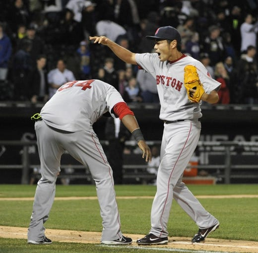 Apr 17, 2014; Chicago, IL, USA; Boston Red Sox relief pitcher Koji Uehara (19) and designated hitter David Ortiz (34) celebrate after their win against the Chicago White Sox during the ninth inning at U.S Cellular Field. The Boston Red Sox defeated the Chicago White Sox 3-1. Mandatory Credit: David Banks-USA TODAY Sports