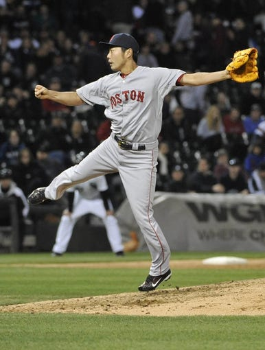 Apr 17, 2014; Chicago, IL, USA; Boston Red Sox relief pitcher Koji Uehara (19) pitches against the Chicago White Sox during the ninth inning at U.S Cellular Field. The Boston Red Sox defeated the Chicago White Sox 3-1. Mandatory Credit: David Banks-USA TODAY Sports