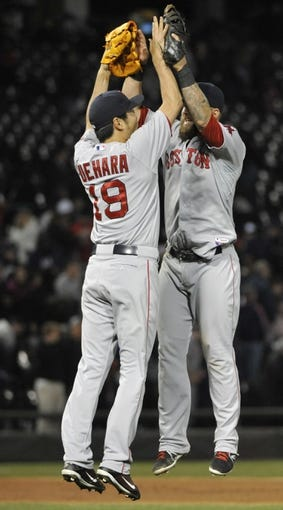Apr 17, 2014; Chicago, IL, USA; Boston Red Sox relief pitcher Koji Uehara (19) and first baseman Mike Napoli (12) celebratee after their win against the Chicago White Sox during the ninth inning at U.S Cellular Field. The Boston Red Sox defeated the Chicago White Sox 3-1. Mandatory Credit: David Banks-USA TODAY Sports